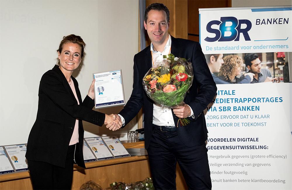 Tom Koning ontvangt Zilveren Predicaat SBR Banken voor kredietrapportages